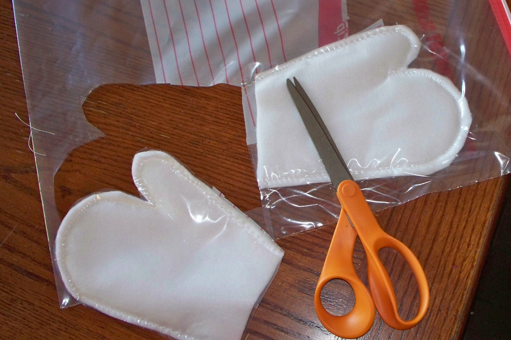Cutting out mitten with plastic