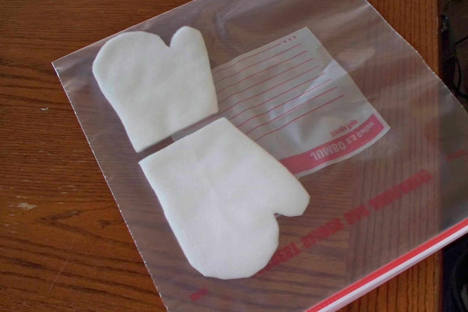 Mitten inserted in plastic