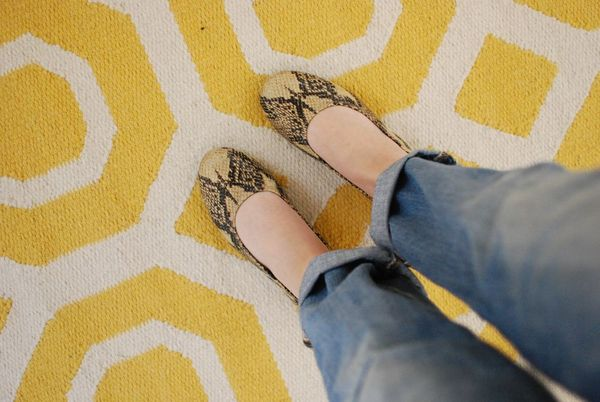 Leopard flats on yellow rug