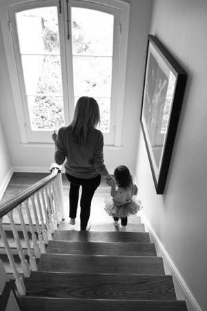 Mom and daughter on stairs