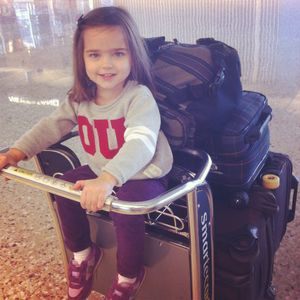 Traveling with kids pigtail luggage cart
