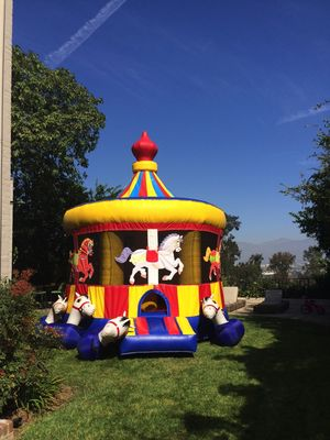Birthday party carousel bounce house
