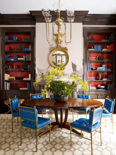 Steven Gambrel dining room with painted bookshelves and funky chairs