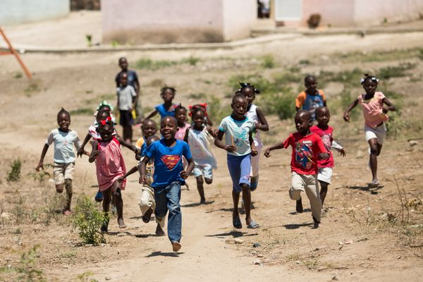 Haiti ferrier village kids running