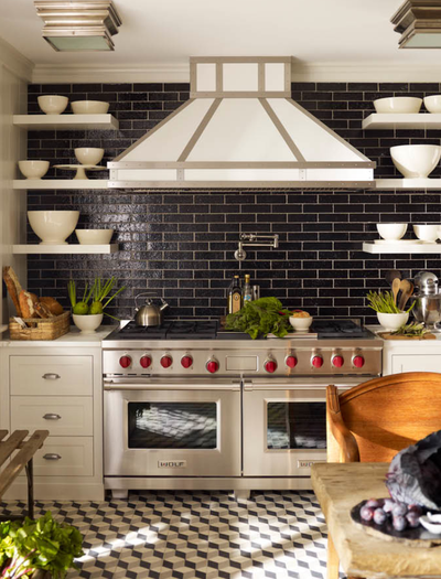 Steven Gambrel kitchen with black subway tile and custom hood